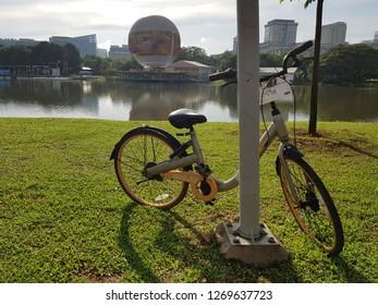 Putrajaya, Malaysia. November 4, 2018. A bicycle from oBike, a bicycle sharing platform, left at the lamp post at Putrajaya Lake near Ayer8 Putrajaya