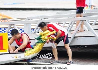PUTRAJAYA, MALAYSIA - OCTOBER 21: Unidentified team prepares during the  IDBF Cancer Survivirs World Cup 2011 & Malaysia International Dragon Boat Festival 2011 in Putrajaya, Malaysia on Oct 21, 2011.