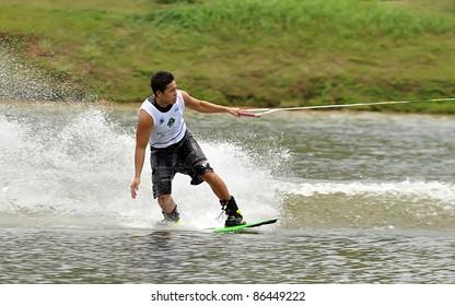 PUTRAJAYA, MALAYSIA - OCTOBER 8: An unidentified participant shows his skills during 2011 IWWF Asian Waterski & Skateboard Championships in Putrajaya, Malaysia on October 8, 2011.