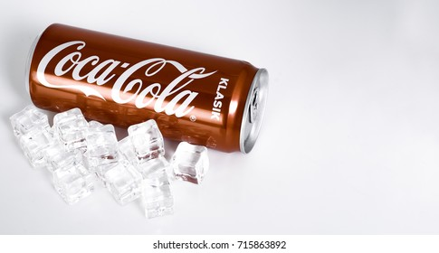 PUTRAJAYA, MALAYSIA - SEPTEMBER 14th, 2017 : Coca Cola classic or klasik drink with a cube of ice on white isolated background.