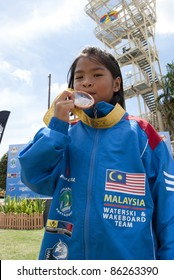 PUTRAJAYA, MALAYSIA-OCTOBER 9: Hanifah Aaliyah Yoong 8 years old from Malaysia wins the bronze medal at 2011 IWWF Asian Waterski & Wakeboard Championships in Putrajaya, Malaysia on October 9, 2011.
