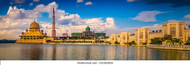 Putrajaya skyline. Amazing view of Putra mosque, Perdana Putra and Putra bridge at sunset. Panorama