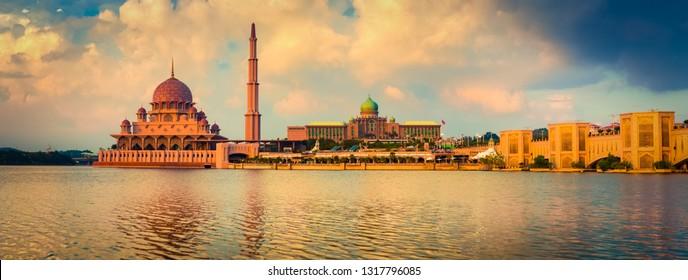 Putrajaya skyline. Amazing view of Putra mosque, Perdana Putra and Putra bridge at sunset. Panorama