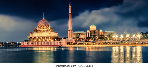 Putrajaya skyline. Amazing view of Putra mosque, Perdana Putra and Putra bridge at night time, Panorama