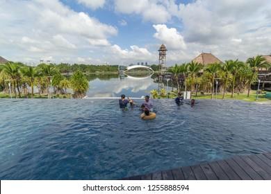 PUTRAJAYA,MALAYSIA- DECEMBER 3 2018: People enjoys at swimming pool and recreational facilities at Pullman Lakeside Resort Putrajaya during school holiday in Malaysia