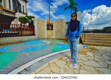 Putrajaya,Malaysia- November 24th,2018:A woman standing beside a child swimming pool in the Pullman Putrajaya Lakeside hotel. This is one of the best 5 star hotel in Malaysia.