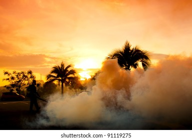 PUTRAJAYA,MALAYSIA-NOV.27:Unidentified man fogs surrounding area to prevent dengue at sunset on November 27, 2011 in Putrajaya,Malaysia.Fogging is one of requirement to kill the Aedes mosquito