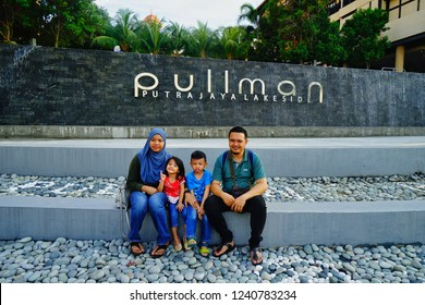 Putrajaya,Malaysia-November 24th,2018:A photo of a family taken in front of Pullman Putrajaya Lakeside hotel infinity pool.This is one of the best 5 star hotels in Malaysia.