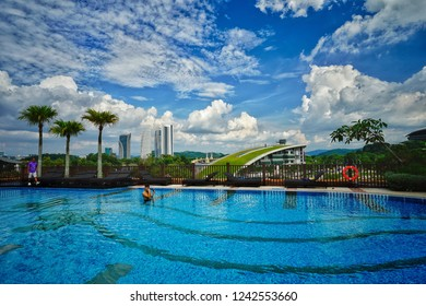 Putrajaya,Malaysia-November 25th,2018:Great landscape view of the Pullman Putrajaya Lakeside swimming pool with great architectural building as background.This is one of the best hotels in Malaysia