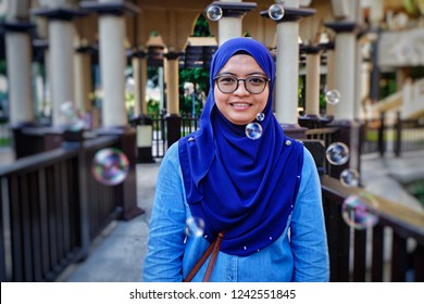 Putrajaya,Malaysia-Portrait shot of a woman with bubles around her in Pullman Putrajaya Lakeside Hotel. This is one of the best 5 stars hotel in Malaysia.
