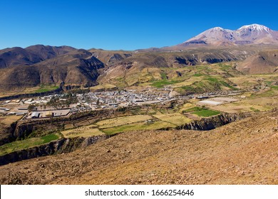 Putre, Chile - October 21, 2013: View to Putre town backdropped by Taapaca volcanic complex in the Parinacota Province in the Arica-Parinacota Region in Chile.