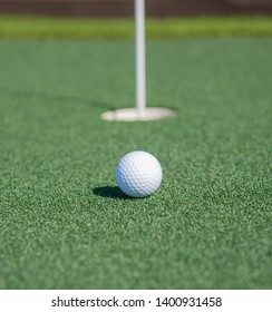 The putt, from relatively near the hole.