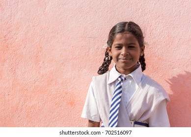 PUTTAPARTHI, ANDHRA PRADESH, INDIA - JULY 9, 2017: Portrait of an Indian girl. Copy space for text