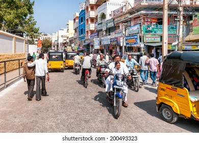 PUTTAPARTHI, INDIA - JANUARY 13, 2013: Street scene of Puttaparthi town.Is a town in Anantapur district of Andhra Pradesh,India. It was the residence of the notable spiritual teacher Sathya Sai Baba.