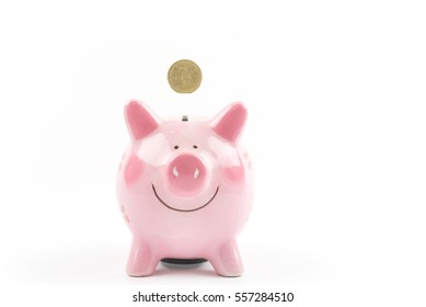 putting coin with piggy bank with money and  isolated background