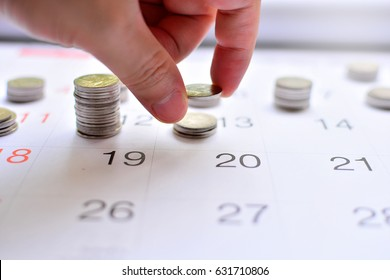putting coins on calendar concept for saving money to finance business investment fund