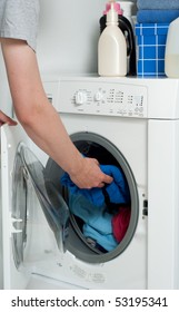 Putting Dirty laundry into Washer