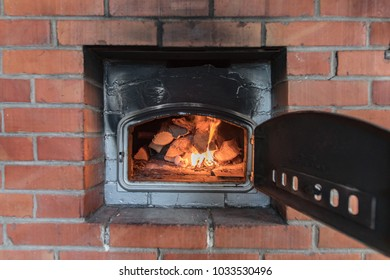 Putting Fire In An Old Baking Oven