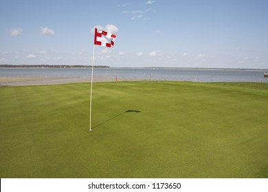 putting green on golf course overlooking ocean