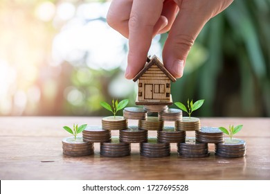 putting house model on money coins saving for concept investment mortgage fund finance and refinance home loan