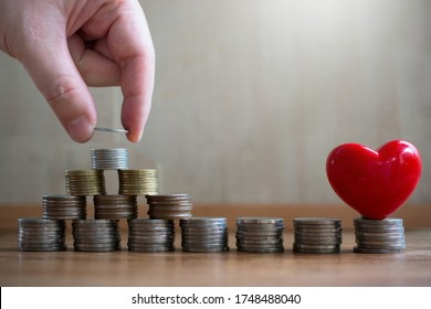 putting money coin saving for concept philanthropy ,donation and finance insurance