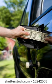 putting money into the gas tank