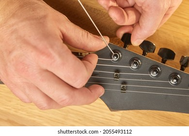 Putting new string on an electric guitar, string changing and tuning