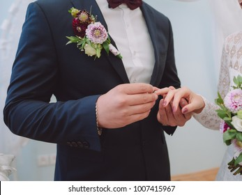 putting on the rings during civil marriage registration ceremony