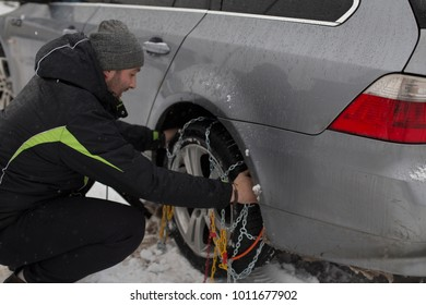 Putting the snow chains on in progress.
