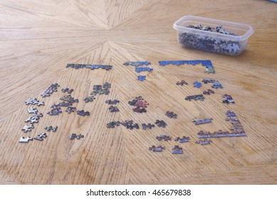 Putting together a jigsaw puzzle. House, home and living concepts.
