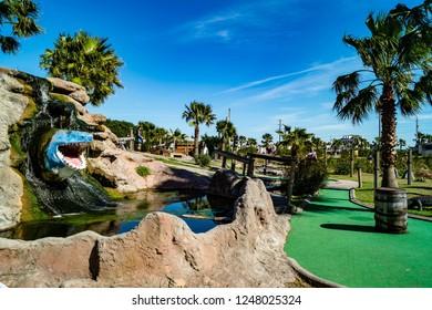 Putt-putt miniature golf course with decorative shark head