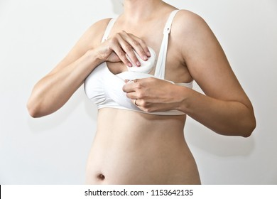Puttting a nursing pad in the nursing bra