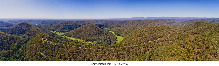 Putty road running on the top of hill range through gum-tree woods along Colo river in Colo heights part of Blue mountains national park in Australia.