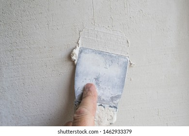 Putty the wall with an old spatula.