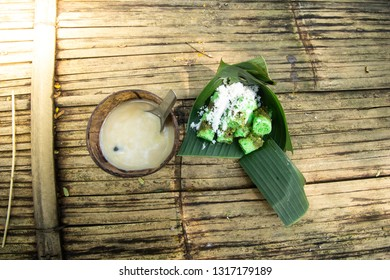 putu cake is a traditional Javanese cake made from rice and filled with Javanese sugar, steamed with bamboo and served on banana leaves