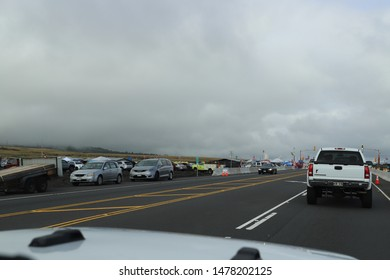 Puu Huluhulu, Hawaii / USA - August 8, 2019: Protestors and Hawaiian flags fill the area around Mauna Kea access road, stopping traffic and construction of the Thirty Meter Telescope or TMT.