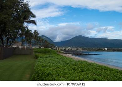 Puu Kukui mountains sea housing and palm trees
