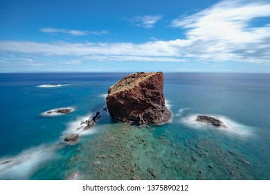 Puu Pehe / Sweetheart Rock with crashing waves on Lanai, Hawaii