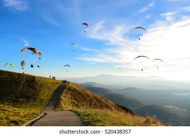 Puy-de-Dome, Auvergne, France - NOVEMBER 01, 2016: Paragliders over the volcano Puy de Dome