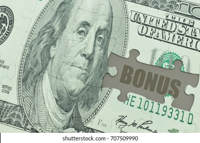 puzzle with the dollar banknote and the text bonus. economy concept