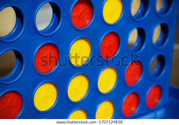 Puzzle game with red and yellow counters
