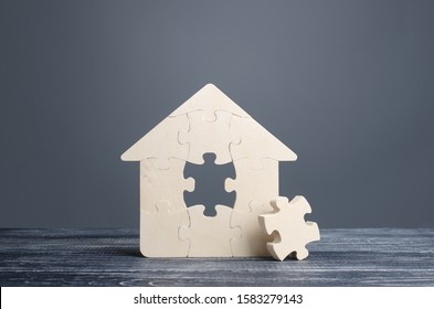 Puzzle house with a missing piece. The acquisition or construction comfortable dream home. Mortgage loan purchase real estate. Arrangement premises repair. Availability and cheapness. Finish building