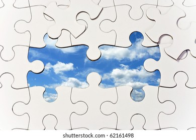 Puzzle with Missing Pieces to Reveal Blue Sky
