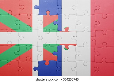 puzzle with the national flag of basque country and france . concept