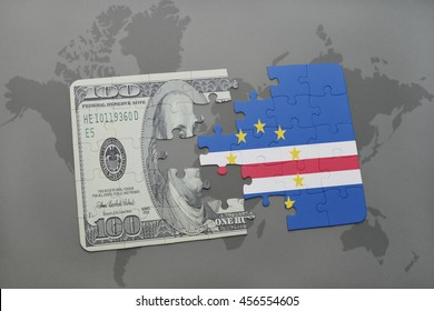 puzzle with the national flag of cape verde and dollar banknote on a world map background. 3D illustration