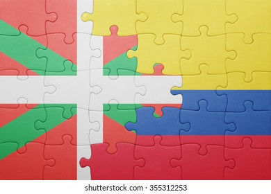 puzzle with the national flag of colombia and basque country . concept