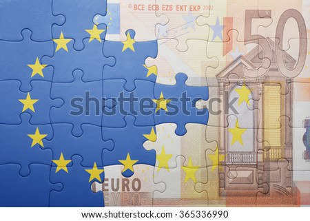puzzle with the national flag of european union and euro banknote . concept