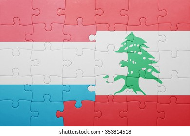 puzzle with the national flag of luxembourg and lebanon . concept