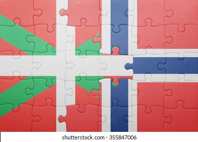 puzzle with the national flag of norway and basque country . concept
