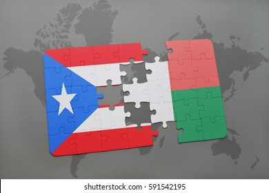 puzzle with the national flag of puerto rico and madagascar on a world map background. 3D illustration